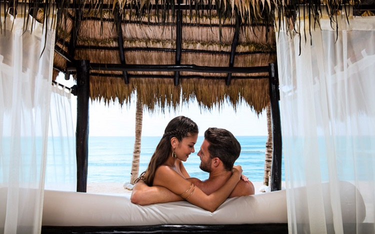 CTI_1297_COUPLE_IN_POOL Clothing Optional Resorts in the Caribbean